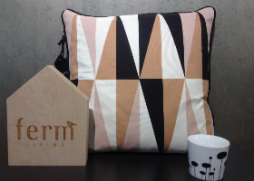 Cojín y taza diseño Ferm Living